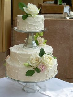 a pretty white cake made by our pastry team-laurel point- I would just have top layer please.