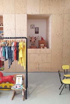 Plywood wardrobe at Achtung! Baby | a store in The Hague, the Netherlands | second-hand children's clothing and vintage wooden toys