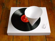 Manual record player made entirely out of paper