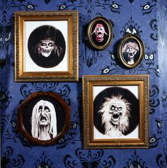"""photo of several framed portraits of ghouls on wall featuring eyes designed by """"Museum of the Weird"""" creator Rolly Crump and Claude Coats"""