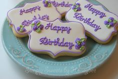this is a great tutorial on writing on cookies and the easy flowers - love it!
