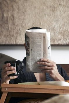 man reading newspaper while drinking coffee.. it's the simple things that i find beautiful..