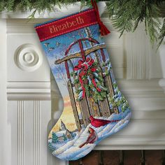 Dimensions Christmas Sled Stocking - Cross Stitch Kit. Kit contains 16 ct. Dove Grey Aida, wool yarn, cotton threads, metallic thread, felt, beads, color-coded