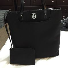 """New Tommy Hilfiger black handbag Brand new w/o tags, black canvas with patten leather handles and bottom of bag is also patten leather...has 3 pockets on the inside of the bag and a detachable pouch they can be in the inside of the bag or hanging on the outside of the bag, whichever you prefer...measurements are 14""""14""""4 strap drop is 11 inches Tommy Hilfiger Bags Totes"""