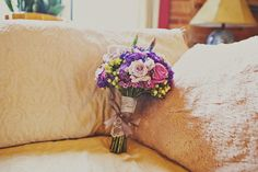Vintage inspired bouquet in purples with hydrangea, roses, berries, waxflower by Brocade Designs