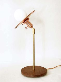 This copper modern table lamp is a unique design piece handmade and handcrafted in our studio with sustainable materials. Good for our planet.