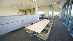 The office fit out for Port of Brisbane Authority features Bris' glass and aluminium partitioning systems throughout.