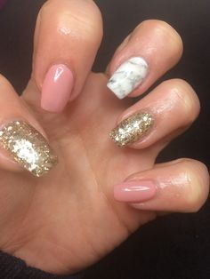 Nude Pink and gold glitter nails with a marble accent: short coffin nails