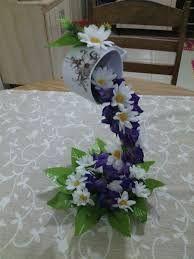 Resultado de imagem para cascata de flores em xicaras