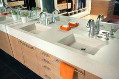Modern bathroom countertop and integral sink design.  Pourfolio Custom Concrete San Diego, CA