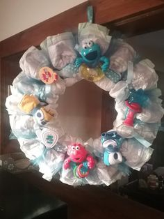 This Diaper Wreath makes a great baby shower gift for the new mom. It also looks wonderful as a babys nursery/ room décor. All of my Diaper Cakes are easily dissembled and are completely useable. No glue are applied directly to the diapers. Rubber bands, tape, paperclips and