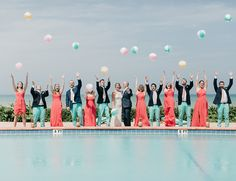 From the color scheme to the location, this poolside aqua and coral summer wedding is the picture of the season. The bridal party could brighten up any room and we could hang out at the beachfront venue all day long!