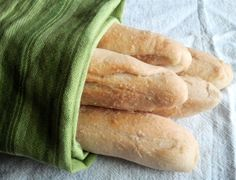 Olive Garden Breadsticks• 1-½ cup Hot Water • 2 Tablespoons Sugar • 1 Tablespoon Yeast • 1 Tablespoon Salt • 2 Tablespoons Butter, Softened • 4-½ cups Flour • 3 Tablespoons Butter, Melted • 1 pinch Kosher Salt • ¼ teaspoons Garlic Powder