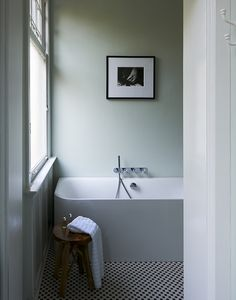 STOCK INTERIORS by Leonie Hendrikse & Jeroen Stock - Bathroom - Interior design by Stock Interiors - Photography by Carin Verbruggen - From our book Dutch Interior Design published by teNeues - blue, light blue, light, white, art, bath, tiles, window, design, interior design, door
