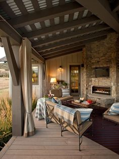 Another awesome covered porch with fireplace!