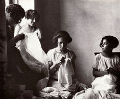 Women embroidering at home.