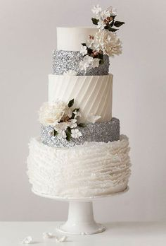 Brides.com: . Inspired by the beauty of ballet, self-taught pastry artist Jenna Illchuk of Jenna Rae Cakes created this graceful cake that's absolutely perfect for a winter wedding. The fondant frills capture the femininity of a ballerina's tutu, while the tiers of edible silver sequins are a nod to their gorgeous beaded costumes.   $12 per slice, Jenna Rae Cakes