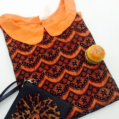 HPPlus size Sleevless orange blouse 100%polyester with cute lace design. Throw a black cardigan for elegant look or dress it up casual with black trousers . With key hole at back .  measures length : 28 Armpit to armpit : 26 Tops Blouses