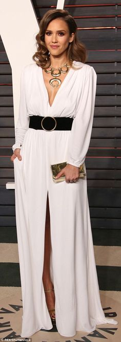 The actress kept one hand in her Roberto Cavalli gown's pocket