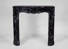 Antique Louis XV style fireplace, Pompadour model, in Black Marquina marble (Reference 3381) - Available at Galerie Marc Maison #fireplace #antique #french #frenchantiques #pompadour #marcmaison #fleamarket #saintouen #paris