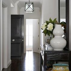 Long foyer features black beveled mirror over black console table filled with white gourd vases and books. Foyer Design, House Design, House Star, Entrance Foyer, Home Upgrades, Building A House, Sweet Home, Interior Design, House Styles