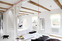 Another gorgeous room with exposed wooden beams