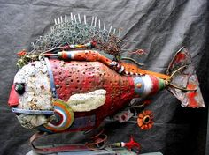 """The fish in the Iron Mask 004.jpg  Assemblage of various materials.   fish can swing a little and a small """"gling"""" musical is hidden in its base"""