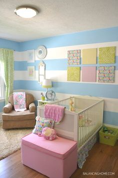 bright baby nursery - this is so adorable, the art squares on the wall could be made with Babyville Boutique PUL stapled to artist frames, how easy!