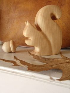 Sweet little hand carved wooden squirrel  figure toy with a wooden acorn made by prettydreamer on etsy