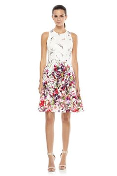 Go back in time with this vintage inspired fit and flare dress. The full skirt and floral pattern are gorgeous throwbacks to a classic era while the cinched waist and contrasting skirt and top keep this look current and  unexpected. <P><br><b>   Inspired by Amal Clonney   Read our Blog  Post</b>  </P>  <br>  <br> -Cotton;  Fully  Lined.  <br><br> -  Center Back Exposed  Zipper.<br><br> -Dry Clean Only. <br>  <br> -  Approximate length waist to hem: 21 1/2 in.