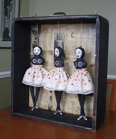 Dolls handcrafted by Jane DesRosier, via the artist's blog.