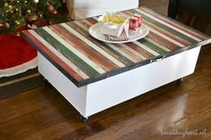 A storage coffee table on casters made from a white bookshelf and stained yardsticks.