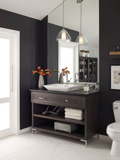 Add a pendant above your bathroom sink for a fresh, modern look. #interiordesign #lighting | Featuring the Progress Lighting Modera pendant