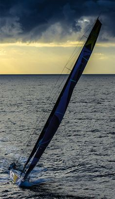 A racing yacht making good headway against a dramatic Southern Ocean sky.