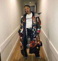 Rihanna Instagram Dolce Gabbana padded coat and Vanda fur handbag, Celine logo t-shirt, Proenza Schouler PSWL belt