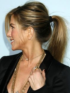 Jennifer Aniston wearing a ribbon hair tie http://beautyeditor.ca/2014/01/05/ribbon-hair-ties/