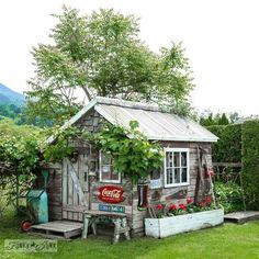 LOVE A Vintage Coca Cola Sign Pairs With A Couple Of Antique License Plates  To Add Character To The Outside Of This Rustic Garden Shed.