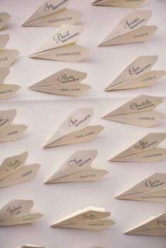Travel theme escort cards - paper planes (by Allison Miracco, Photo by Ryan + Heidi)>>>>TELL YOUR FRIENDS that we'd love to see them at our aviation themed restaurant, The Left Seat West, in Glendale, Arizona!! Check out our décor at: http://www.facebook.com/pages/Left-Seat-West-Restaurant/192309664138462 #aviationwedding