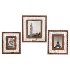 """Set of three wire picture frames with landmark photos and a distressed rust border.  Product: Small, medium, and large picture frameConstruction Material: Metal, glass, and paperColor: Brown rustFeatures: Holds photo sizes 4"""" x 6"""", 5"""" x 7"""" and 8"""" x 10"""" Dimensions: Small: 12"""" H x 10"""" WMedium: 13"""" H x 11"""" W Large: 16"""" H x 14"""" W"""