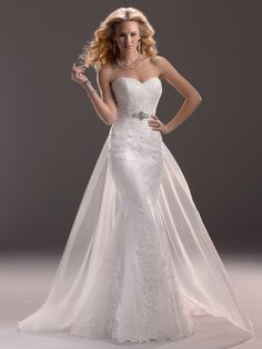 Maggie Sottero - LUCY, Head-to-toe lace is a classic favorite in this fit and flare gown. Finished with strapless sweetheart neckline and signature corset back closure.