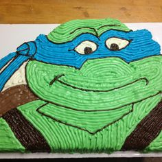 Teenage Mutant Ninja Turtle cake.  The top is cut out (started as a 12x18 sheet cake).  It's covered in buttercream.