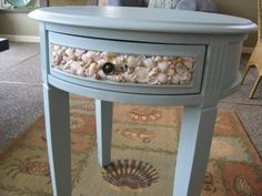 Pretty shell table found at Home At The Beach (facebook)