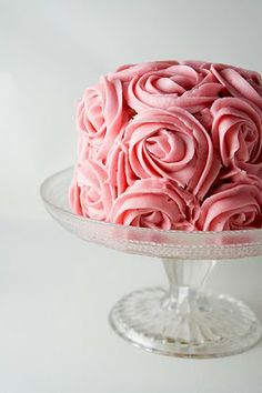 The rose decoration on this is amazing.  This links to a blog in Spanish but from there you can link to the original tutorial in English.  The cake looks so much better in pink than white though!