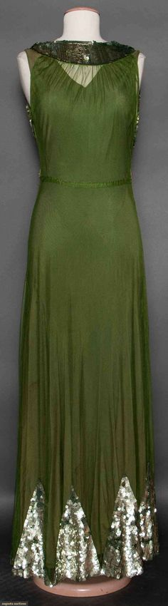 SEQUINED GREEN EVENING GOWN, LATE 1930s Olive green cotton net, sleeveless, low cut B, wide band of silver sequins for Hi collar, long skirt w/ pattern of sequined triangles at hem, heavy silk bias cut matching underdress