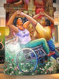 San Fran mural of two Latino women dancing, one using chair