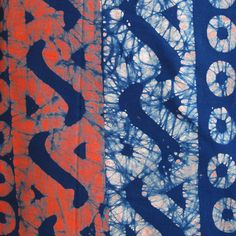 Hand stamped batik created by applying wax with a carved stamp to a solid color base cloth. The wax forms a resist and the cloth is then over dyed. This process may be done multiple times, resulting i