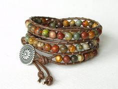 Leather and beads bracelet with a button closure