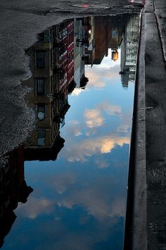 puddle image of the reflection of the buildings you actually don't see. Beautiful. Great photo.
