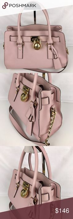"Michael Kors Hamilton Leather Satchel - Blossom Condition: Gently used. Good condition inside and out. A few minor marks on exterior  A structured Satchel in rich Pink (Blossom) Saffiano leather. A polished logo lock fastens front straps, a magnetic tab cinches the top. Lined, 3-pocket interior with tethered spring-lock keyring. Rolled top handles and shoulder strap. Metal feet. 12.25"" L x 9.5"" H x 5"" D. Style 30S2GHMS3L. RB352.  Thank you for your interest!  PLEASE - NO TRADES / NO LOW BALL…"