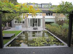 Although this is pinned as a water feature, it must surely be a swimming pool - far too big for a water feature in a small garden, I'd have thought ....